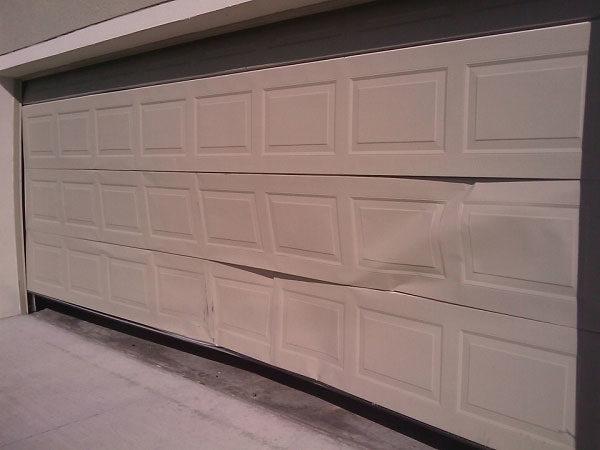 Dented Bent Damaged Garage Door Panels Jb Garage Door Repair Las Vegas Nv